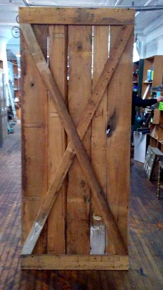 Door made of  reclaimed mixed hardwoods