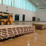 Removing the basketball floor at LeMoyne College