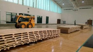 Removing the basketball floor at LeMoyne College