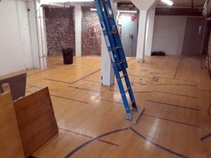 Maple basketball court flooring installed at Young & Wright Architectural